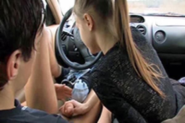 Hot cock sucking in a car